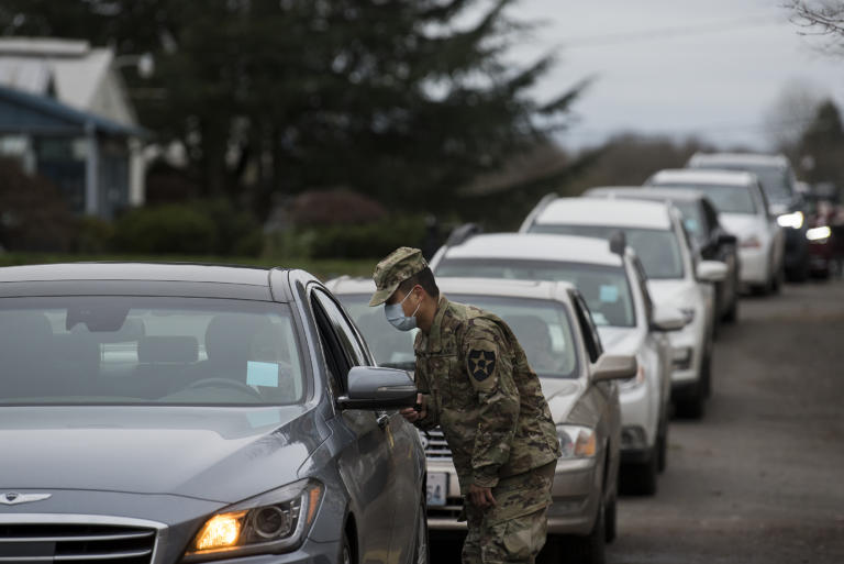 Israel De La Cruz of the National Guard helps direct motorists as they prepare to get their COVID-19 vaccine at the Clark County Event Center at the Fairgrounds on Tuesday morning, January 26, 2021.