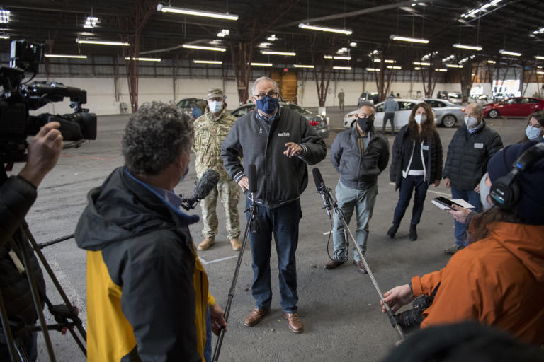 Gov. Jay Inslee speaks to members of the media during a tour of the mass COVID-19 vaccination site at the Clark County Fairgrounds on Thursday morning, January 28, 2021.
