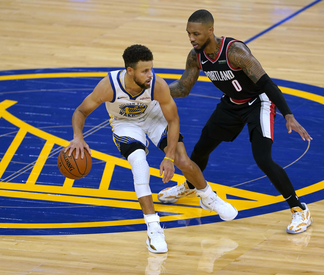 Golden State Warriors guard Stephen Curry (30) dribbles past Portland Trail Blazers guard Damian Lillard (0) during the second half of an NBA basketball game in San Francisco, Friday, Jan. 1, 2021. Portland won 123-98.