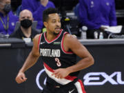 Portland Trail Blazers guard CJ McCollum runs to the other end of the court after scoring against the Sacramento Kings during the second half of an NBA basketball game in Sacramento, Calif., Saturday, Jan. 9, 2021. The Trail Blazers won 125-99.