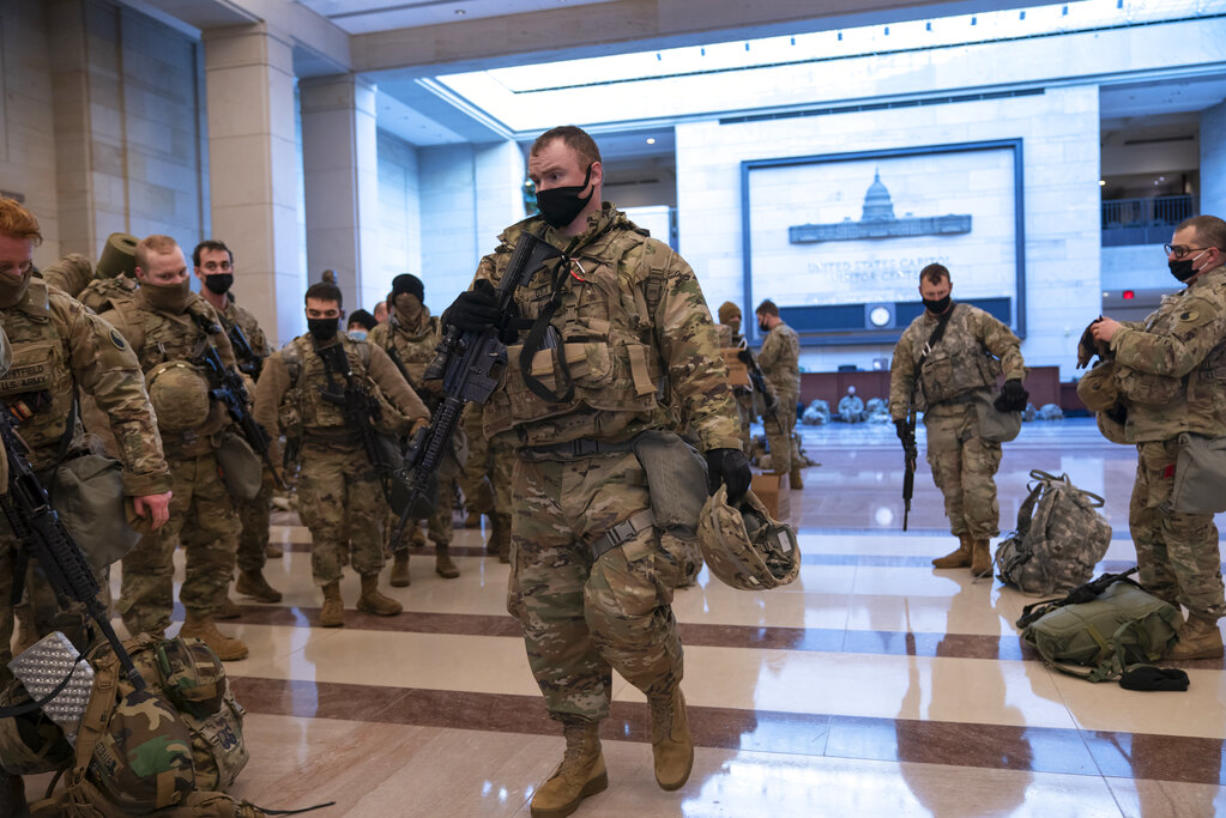 Hundreds of National Guard troops hold inside the Capitol Visitor's Center to reinforce security at the Capitol in Washington, Wednesday, Jan. 13, 2021. The House of Representatives is pursuing an article of impeachment against President Donald Trump for his role in inciting an angry mob to storm the Capitol last week. (AP Photo/J.