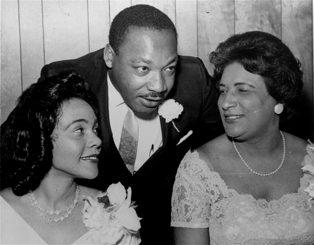 FILE- In this Aug. 9, 1965, file photo, Dr. Martin Luther King, Jr., president of the Southern Christian Leadership Conference, chats with his wife, Coretta, left, and civil rights champion Constance Baker Motley before the start of an S.C.L.C. banquet in Birmingham, Ala.