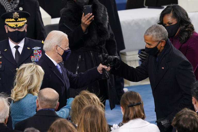 President-elect Joe Biden his greeted by former President Barrack Obama as he arrives for the 59th Presidential Inauguration at the U.S. Capitol in Washington, Wednesday, Jan. 20, 2021.