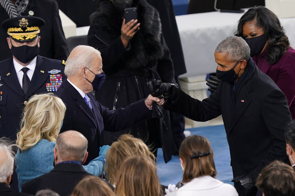President-elect Joe Biden his greeted by former President Barrack Obama as he arrives for the 59th Presidential Inauguration at the U.S. Capitol in Washington, Wednesday, Jan. 20, 2021. (AP Photo/Carolyn Kaster)