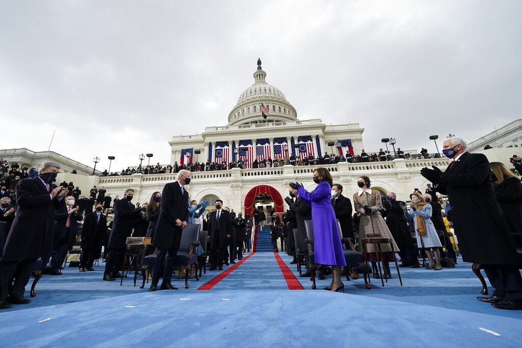 Vice President-elect Kamala Harris applauds as President-elect Joe Biden arrives for the 59th Presidential Inauguration at the U.S. Capitol in Washington, Wednesday, Jan. 20, 2021.