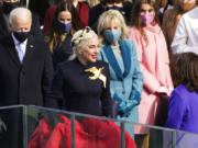 Lady Gaga arrives to sing the National Anthem during the 59th Presidential Inauguration at the U.S. Capitol in Washington, Wednesday, Jan. 20, 2021.