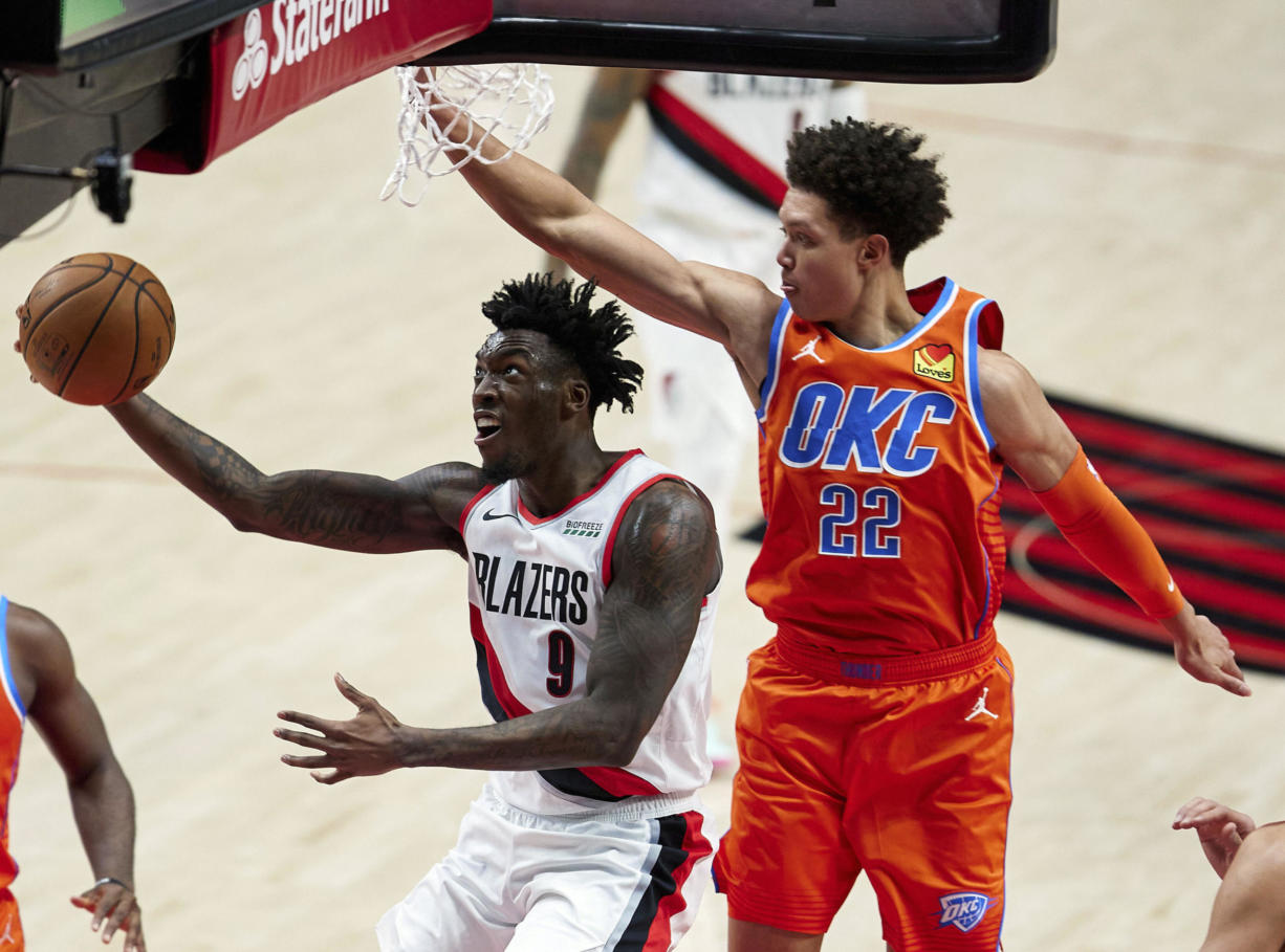 Portland Trail Blazers forward Nassir Little, left, shoots in front of Oklahoma City Thunder forward Isaiah Roby during the first half of an NBA basketball game in Portland, Ore., Monday, Jan. 25, 2021.
