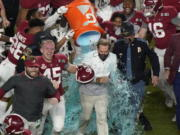 Alabama senior Thomas Fletcher (45) celebrates as head coach Nick Saban is soaked in Gatorade after their win against Ohio State in the College Football Playoff national championship game Jan. 11 in Miami Gardens, Fla. Fletcher, whose 55 career starts were the most on Alabama, was named the winner of the Patrick Mannelly Award, given to the nation's top collegiate long snapper.