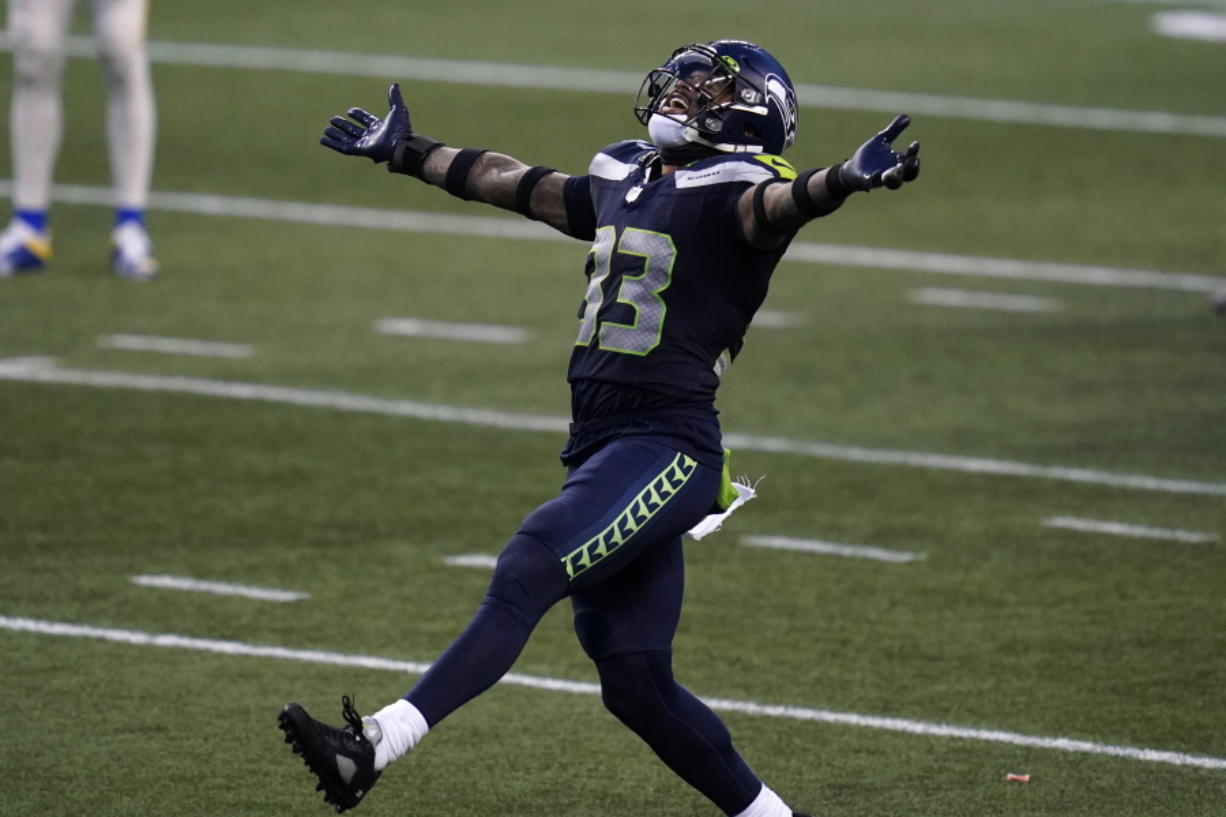 Seattle Seahawks strong safety Jamal Adams (33) reacts to a play against the Los Angeles Rams .