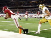 Alabama wide receiver DeVonta Smith (6) catches a pass in the end zone for a touchdown as Notre Dame cornerback Nick McCloud, right, defends in the second half of the Rose Bowl NCAA college football game in Arlington, Texas, Friday, Jan. 1, 2021.