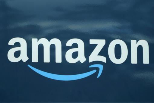 An Amazon logo appears on an Amazon delivery van, Thursday, Oct. 1, 2020, in Boston.  Amazon said Tuesday, Jan. 5, 2021,  that it bought 11 jets from Delta and WestJet airlines to boost its growing delivery network and get orders to shoppers faster. The company said it's the first time it purchased planes for its delivery network.