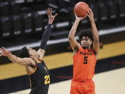 Oregon State's Ethan Thompson (5) shoots over Arizona State's Marcus Bagley (23) during the first half of an NCAA college basketball game in Corvallis, Ore., Saturday, Jan. 16, 2021.