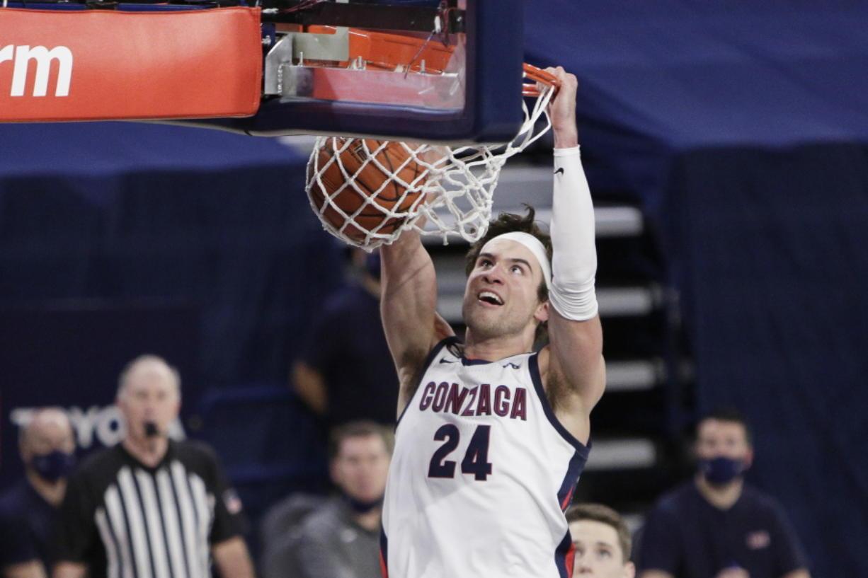 Gonzaga forward Corey Kispert dunks during the second half of an NCAA college basketball game against BYU in Spokane, Wash., Thursday, Jan. 7, 2021.