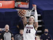 Gonzaga forward Corey Kispert dunks during the second half of an NCAA college basketball game against BYU in Spokane, Wash., Thursday, Jan. 7, 2021.