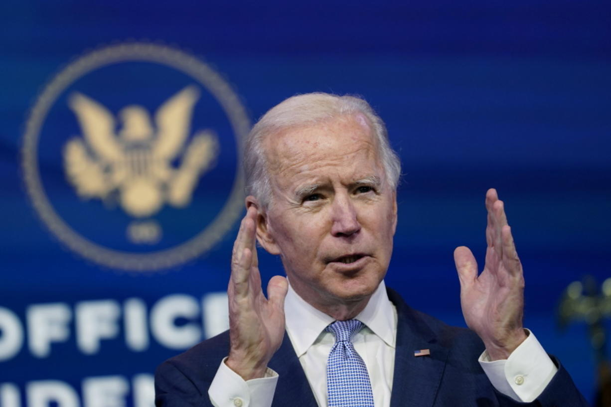 In this Jan. 6, 2021 file photo, President-elect Joe Biden speaks at The Queen theater in Wilmington, Del.