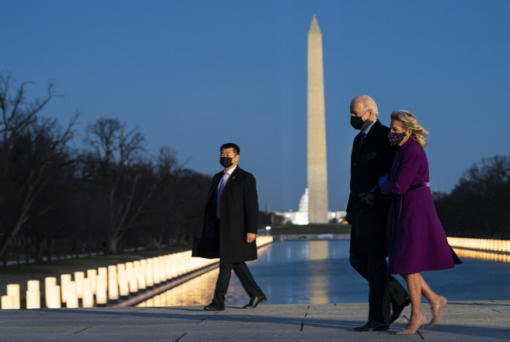 President-elect Joe Biden and his wife Jill Biden leave a COVID-19 memorial event at the Lincoln Memorial Reflecting Pool, Tuesday, Jan. 19, 2021, in Washington.