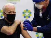 President-elect Joe Biden receives his second dose of the coronavirus vaccine at ChristianaCare Christiana Hospital in Newark, Del., Monday, Jan. 11, 2021. The vaccine is being administered by Chief Nurse Executive Ric Cuming.