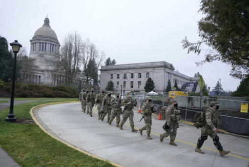 Washington National Guard members walk in formation away from the Legislative Building, Wednesday, Jan. 20, 2021, at the Capitol in Olympia, Wash. Members of the Guard and Washington State Patrol troopers have been in place all week on the campus providing security against possible protests connected with the inauguration of President Joe Biden and the departure of former President Donald Trump in Washington, D.C. (AP Photo/Ted S.