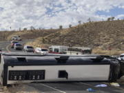 This photo provided by the Mohave County Sheriff's Office shows a Las Vegas-based tour that rolled over in northwestern Arizona on Friday, Jan. 22, 2021. One person died, and two were critically injured. The cause of the rollover is under investigation.