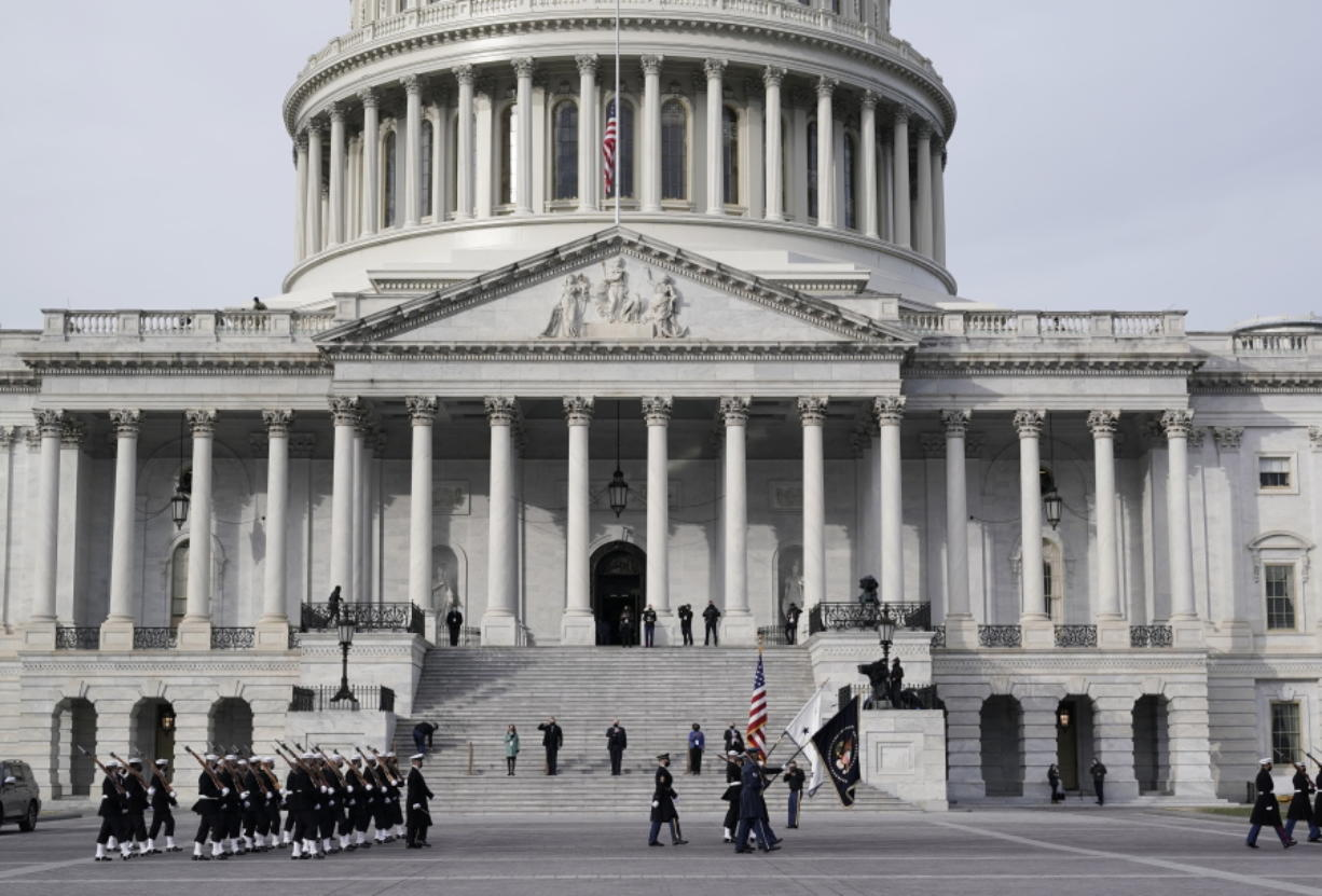 U.S. military units march in front of the Capitol, Monday, Jan. 18, 2021 in Washington, as they rehearse for President-elect Joe Biden's inauguration ceremony, which will be held at the Capitol on Wednesday. (AP Photo/J.