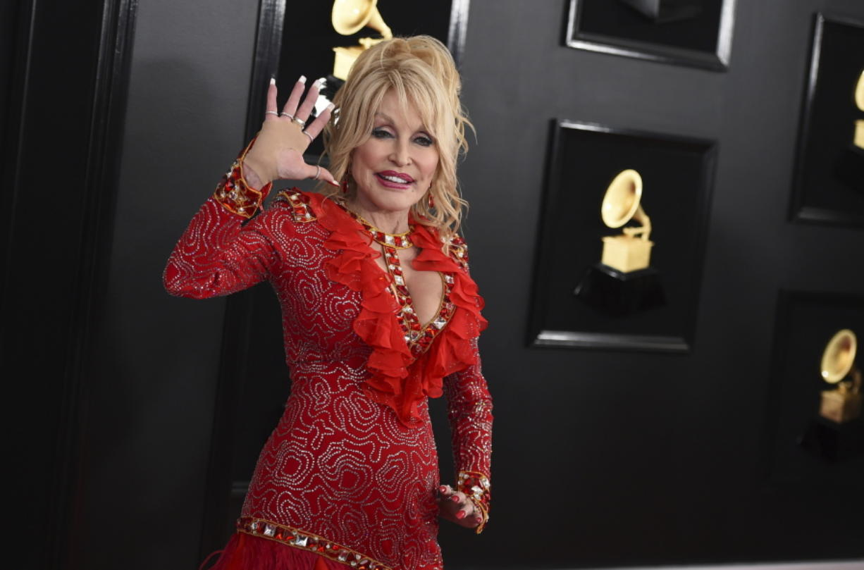 FILE - Dolly Parton arrives at the 61st annual Grammy Awards on Feb. 10, 2019, in Los Angeles. Parton turns 75 on Jan. 19.