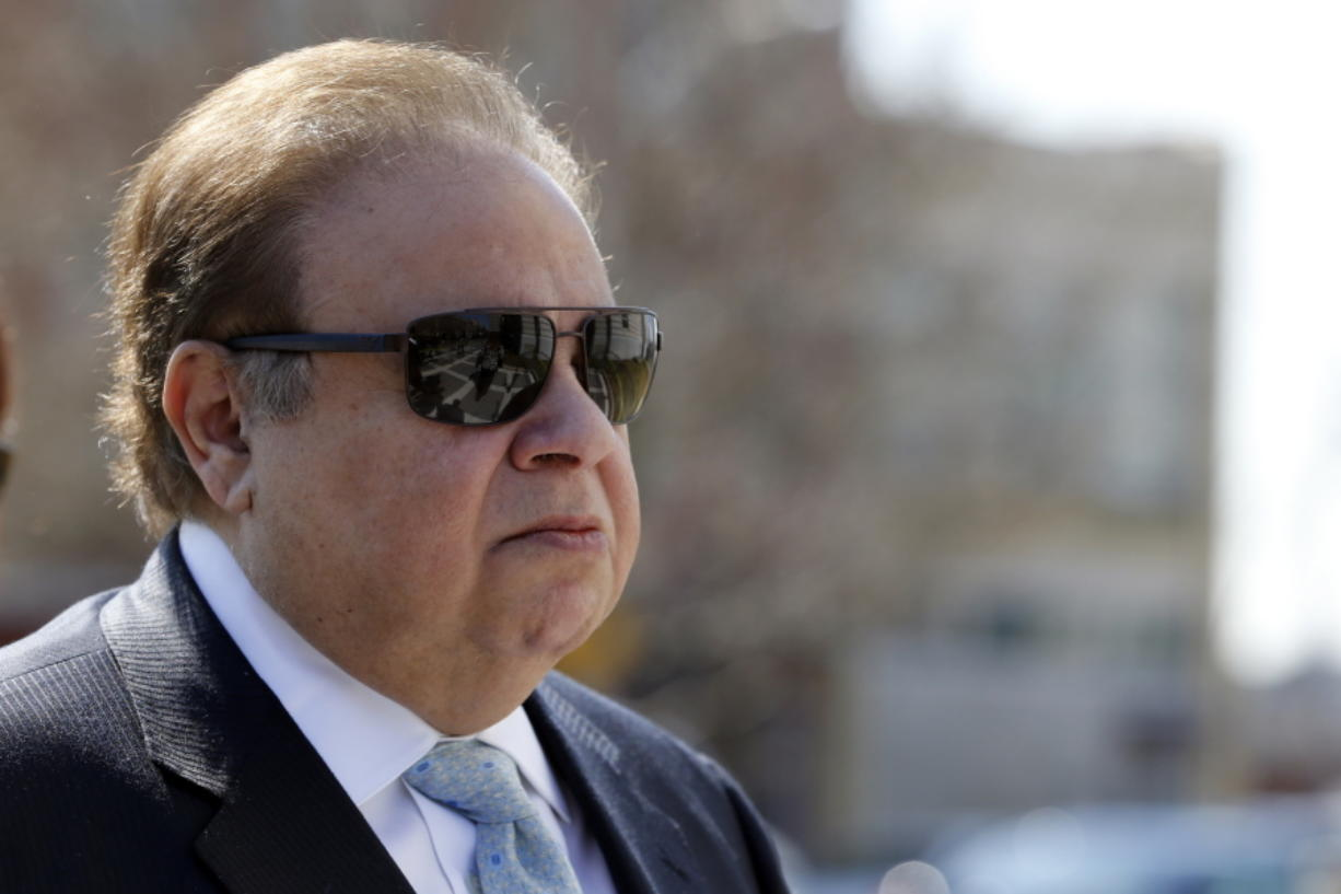 FILE - In this April 2, 2015 file photo, Dr. Salomon Melgen arrives at the Martin Luther King Jr. Federal Courthouse for his arraignment in Newark, N.J. The prominent Florida eye doctor, convicted of defrauding Medicare out of $73 million, got out of prison early on Wednesday, Jan. 20, 2021, after former President Donald Trump commuted his sentence just hours before his term ended.