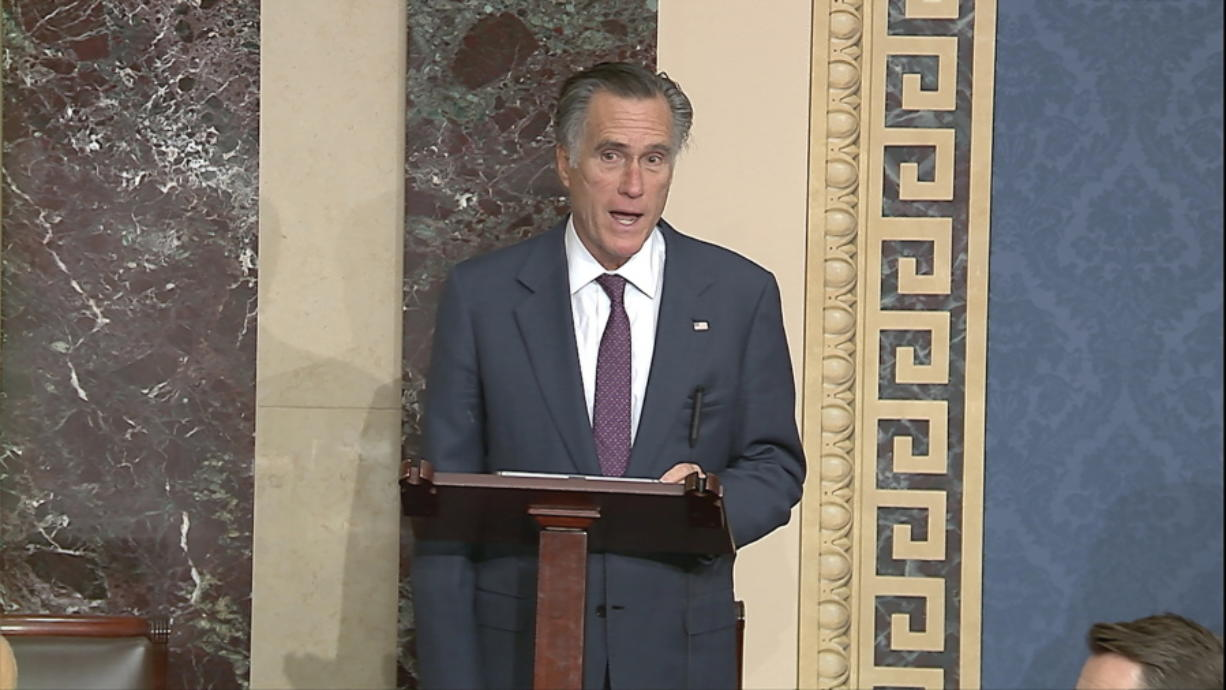 In this image from video, Sen. Mitt Romney, R-Utah, speaks as the Senate reconvenes to debate the objection to confirm the Electoral College Vote from Arizona, after protesters stormed into the U.S. Capitol on Wednesday, Jan. 6, 2021.