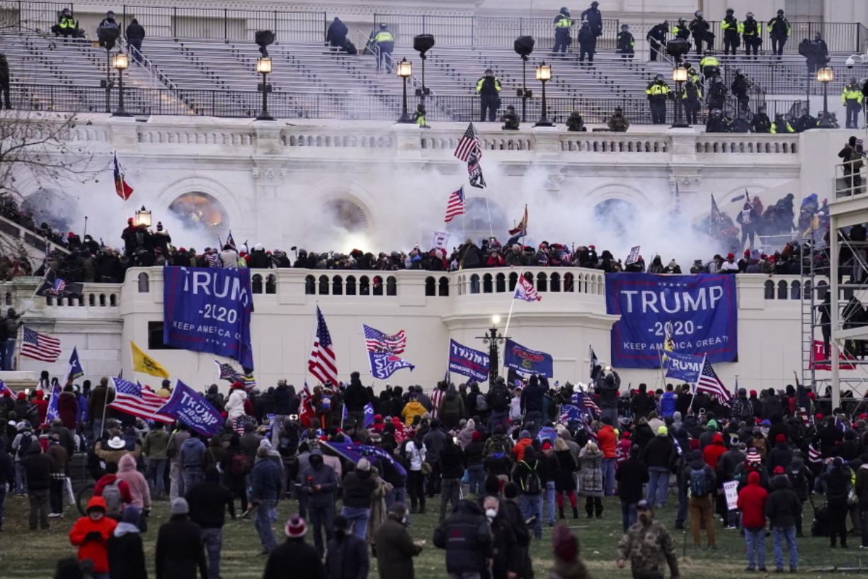 Violent protesters, loyal to President Donald Trump, storm the Capitol on Wednesday in Washington. It was a stunning day as a number of lawmakers and then the mob of protesters tried to overturn America's presidential election, undercut the nation's democracy and keep Democrat Joe Biden from replacing Trump in the White House.