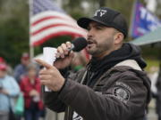 Joey Gibson, leader of Patriot Prayer, a right-wing extremist group based in Vancouver, Wash., speaks during a protest rally, Wednesday, Jan. 6, 2021, at the Capitol in Olympia, Wash., against the counting of electoral votes in Washington, DC, affirming President-elect Joe Biden's victory. Several hundred people supporting President Donald Trump rallied at the Capitol Wednesday. (AP Photo/Ted S.