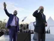 President-elect Joe Biden, right, campaigns Jan. 4 for Senate candidates Raphael Warnock, left, and Jon Ossoff, not pictured, in Atlanta.