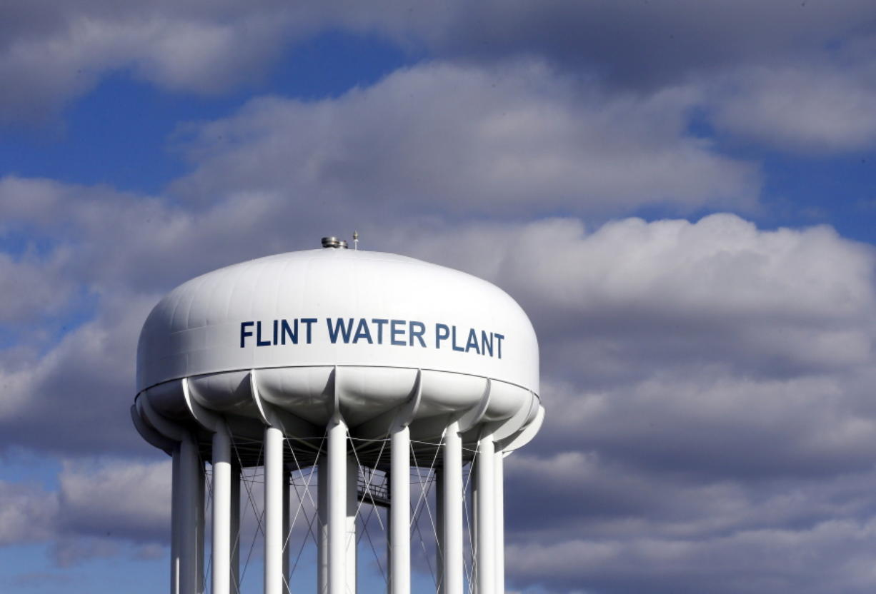 FILE - In this March 21, 2016, file photo, the Flint Water Plant water tower is seen in Flint, Mich. Former Michigan Gov. Rick Snyder, Nick Lyon, former director of the Michigan Department of Health and Human Services, and other ex-officials have been told they're being charged after a new investigation of the Flint water scandal, which devastated the majority Black city with lead-contaminated water and was blamed for a deadly outbreak of Legionnaires' disease in 2014-15, The Associated Press has learned.