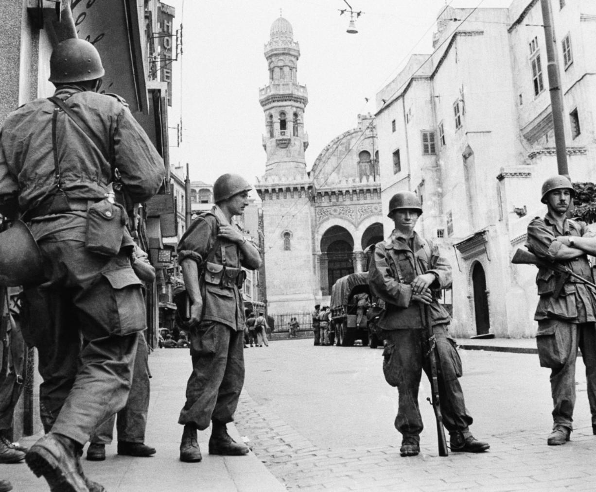 FILE - In this May 27, 1956 file photo, French troops seal off Algiers' notorious casbah, 400-year-old teeming Arab quarter. French President Emmanuel Macron wants to take further steps to reckon with France's colonial-era wrongs in Algeria but is not considering an official apology, his office said.