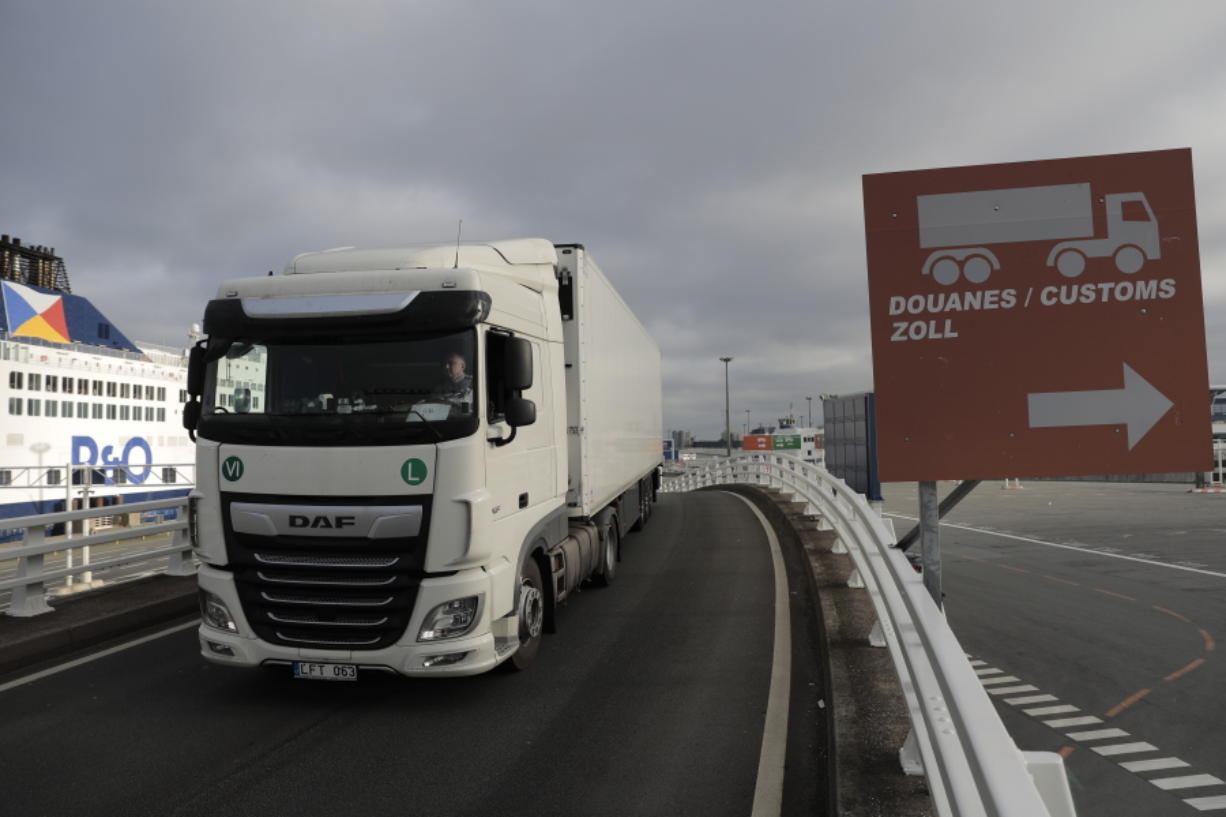 A lorry arrives to board the first ferry heading to Britain after Brexit, Friday Jan.1, 2021 in Calais, northern France. Britain left the European bloc's vast single market for people, goods and services at 11 p.m. London time, midnight in Brussels, completing the biggest single economic change the country has experienced since World War II.