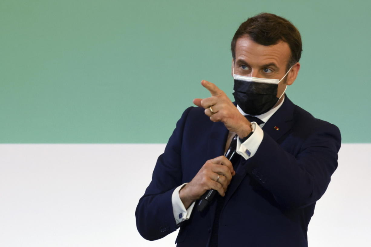 French President Emmanuel Macron gestures as he speaks during the One Planet Summit, at The Elysee Palace, in Paris, Monday Jan. 11, 2021. Protecting the world's biodiversity is on the agenda for world leaders at the One Planet Summit, which was being held by videoconference due to the coronavirus pandemic.