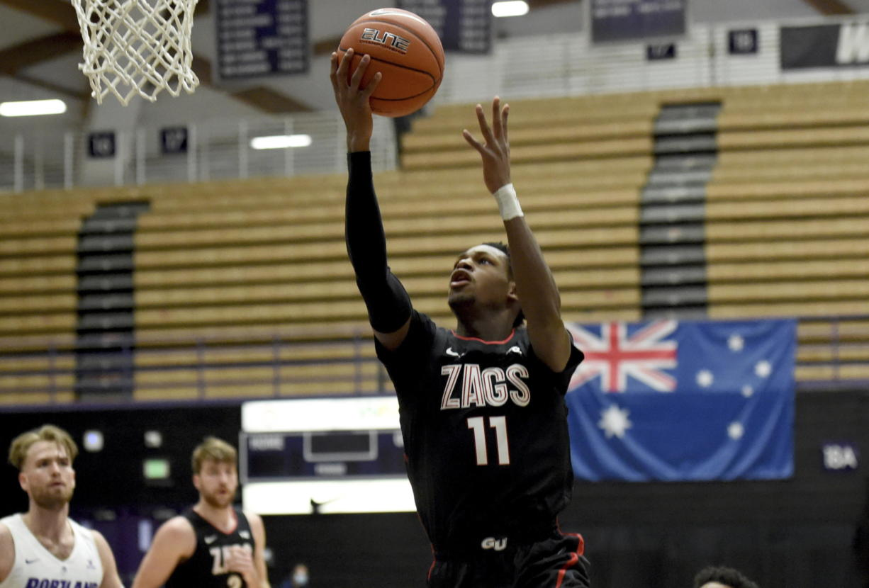 Gonzaga University guard Joel Ayayi, drives to the basket during the first half of an NCAA college basketball game against Portland in Portland, Ore., Saturday, Jan. 9, 2021.