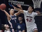 Gonzaga guard Jalen Suggs (1) shoots against Saint Mary's forward Dan Fotu (42) during the second half of an NCAA college basketball game in Moraga, Calif., Saturday, Jan. 16, 2021.