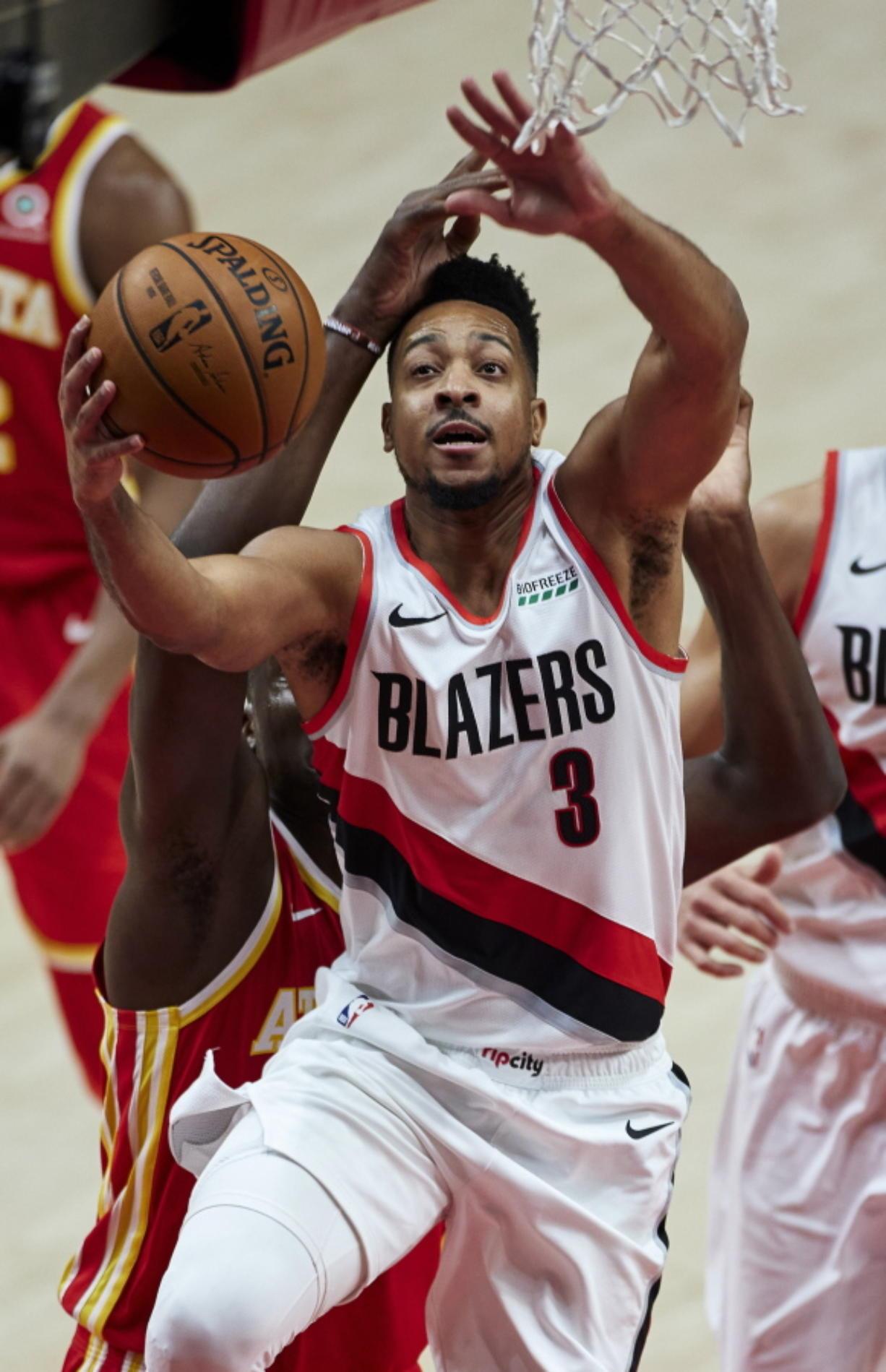 Portland Trail Blazers guard CJ McCollum shoots against the Atlanta Hawks during the first half of an NBA basketball game in Portland, Ore., Saturday, Jan. 16, 2021.