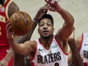 Portland Trail Blazers guard CJ McCollum shoots against the Atlanta Hawks during the first half of an NBA basketball game in Portland, Ore., Saturday, Jan. 16, 2021.