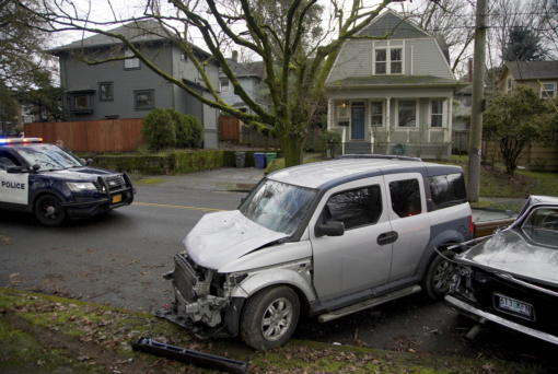 Wrecked vehicles are seen after a driver struck and injured at least five people over a 20-block stretch of Southeast Portland, Ore., before crashing and fleeing on Monday, Jan. 25, 2021, according to witnesses.