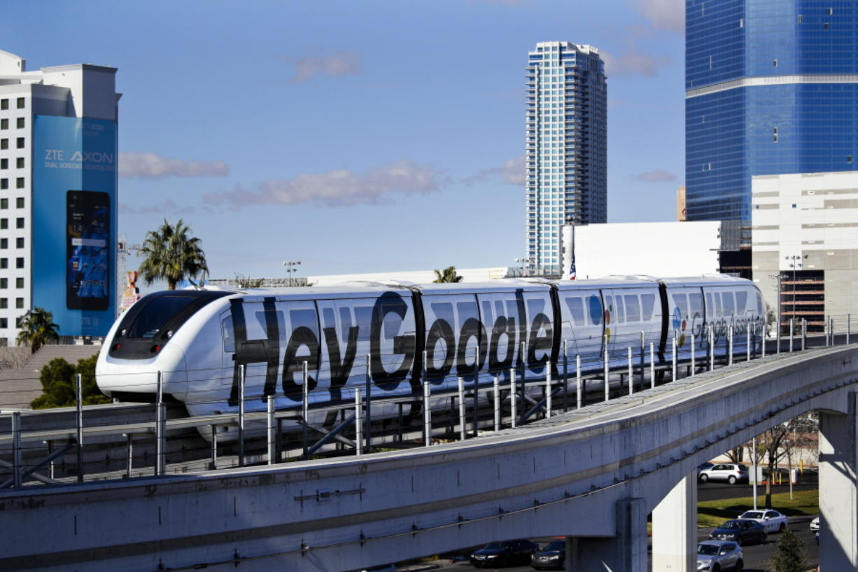 FILE - In this Jan. 10, 2018, file photo, a monorail with a Google advertisement passes the Las Vegas Convention Center during CES International in Las Vegas. The idled Las Vegas Monorail is being bought by the local tourism authority with plans to arrange the system's second Chapter 11 bankruptcy after 16 years of operation by a not-for-profit corporation.  (AP Photo/Jae C.