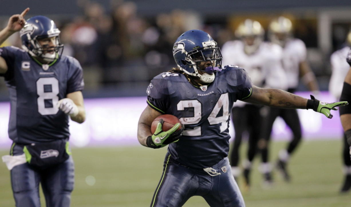 Seattle Seahawks' Marshawn Lynch begins to celebrate after a 67-yard touchdown run against the New Orleans Saints on Jan. 8, 2011, in Seattle.