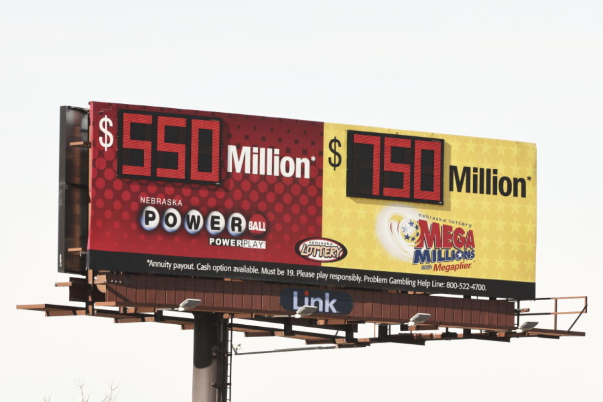 A billboard advertises the jackpots of the Powerball and Mega Millions lotteries, in Omaha, Neb., Wednesday, Jan. 13, 2021. Lottery players will have a shot Friday night at the fifth-largest jackpot in U.S. history after no tickets matched all the numbers in the latest Mega Millions drawing. The big prize for Powerball, the other national lottery game, is $550 million for Wednesday night's drawing.