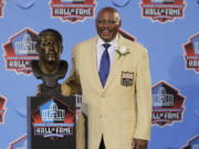 Floyd Little poses with his bust after enshrinement in the Pro Football Hall of Fame in 2010 at Canton, Ohio. Little, the Hall of Fame running back who starred at Syracuse and for the Denver Broncos, has died at age 78. The Pro Football Hall of Fame said he died Friday, Jan. 1, 2021.