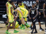 Colorado guard McKinley Wright IV, right, flexes after drawing a foul against Oregon during the second half of an NCAA college basketball game Thursday, Jan. 7, 2021, in Boulder, Colo. Colorado won 79-72.