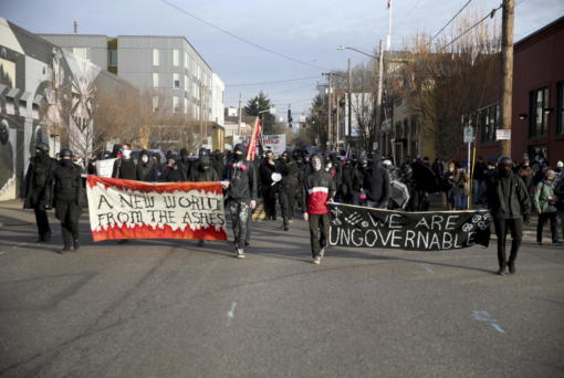 Demonstrators march during a protest on Inauguration Day in Southeast Portland, Ore.
