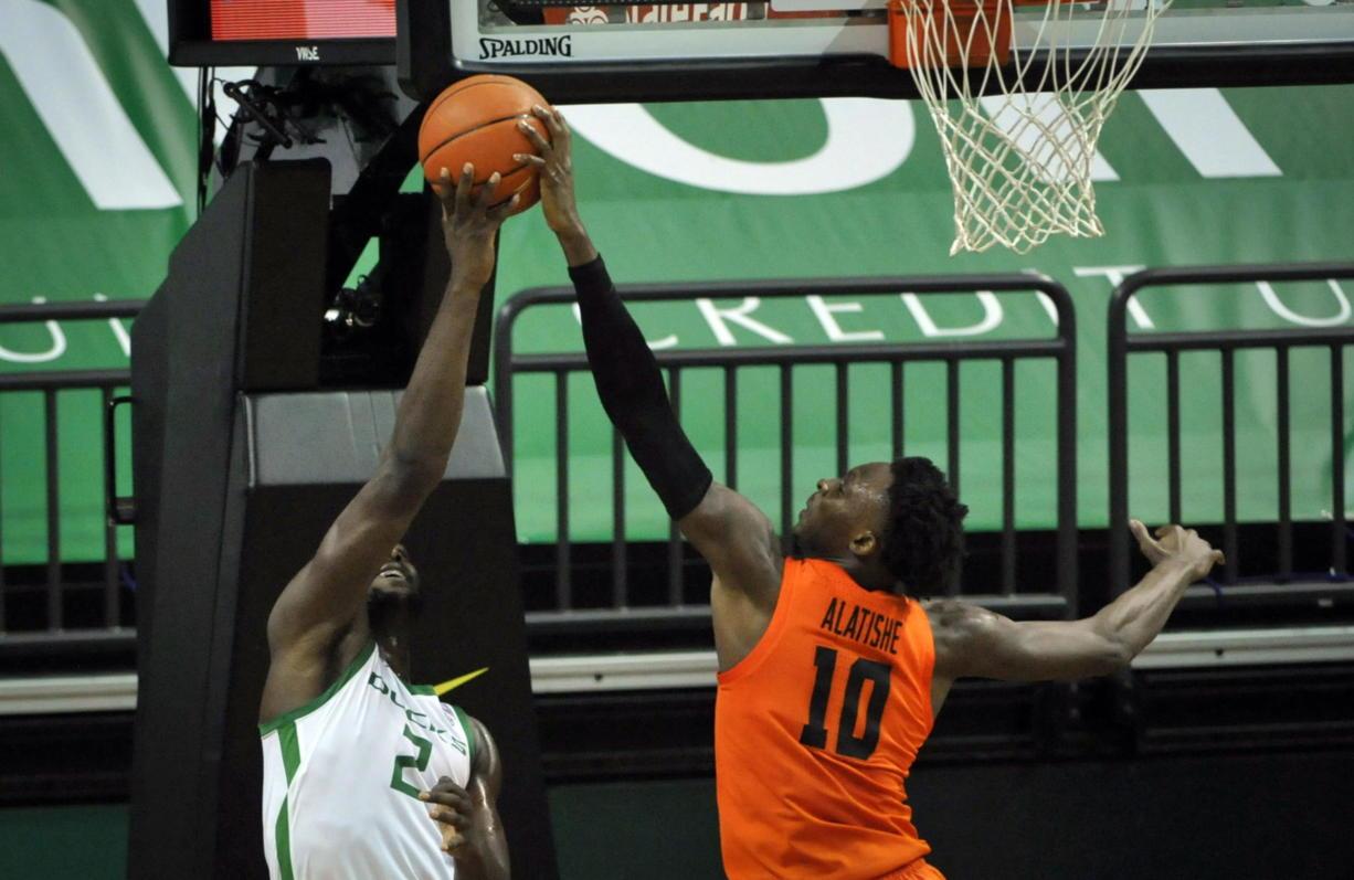 Oregon State forward Warith Alatishe (10) blocks the shot of Oregon forward Eugene Omoruyi (2) during the first half of an NCAA college basketball game Saturday, Jan. 23, 2021, in Eugene, Ore.