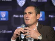 FILE - In this Oct. 7, 2019, file photo, Pac-12 Commissioner Larry Scott speaks to reporters during the Pac-12 Conference women's NCAA college basketball media day in San Francisco. Scott is stepping down at the end of June 2021, ending an 11-year tenure in which the conference landed a transformational billion dollar television deal but struggled to keep up with some of its Power Five peers when it came to revenue and exposure. (AP Photo/D.