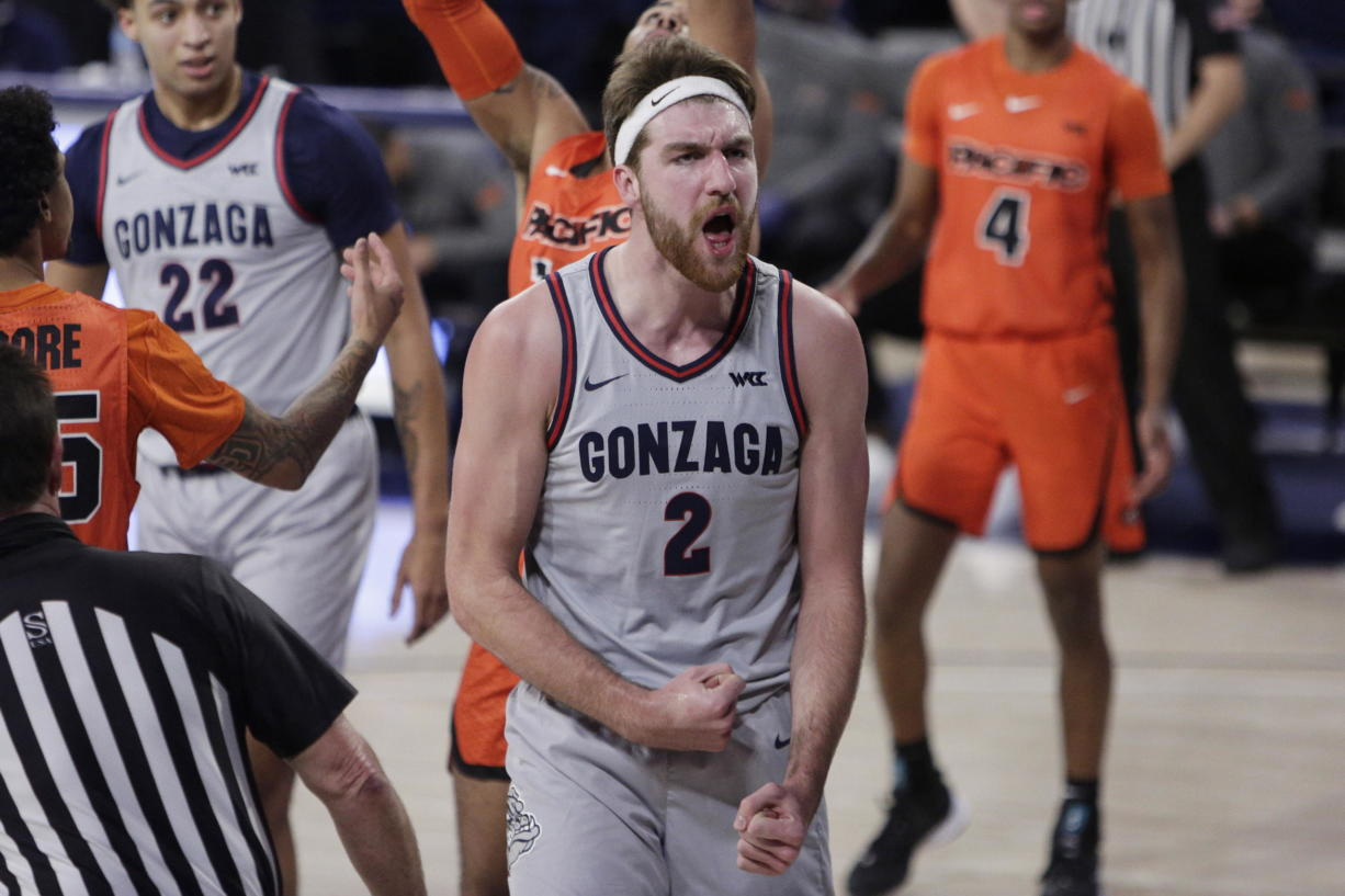 Gonzaga forward Drew Timme celebrates after scoring a basket during the first half of the team's NCAA college basketball game against Pacific in Spokane, Wash., Saturday, Jan. 23, 2021.