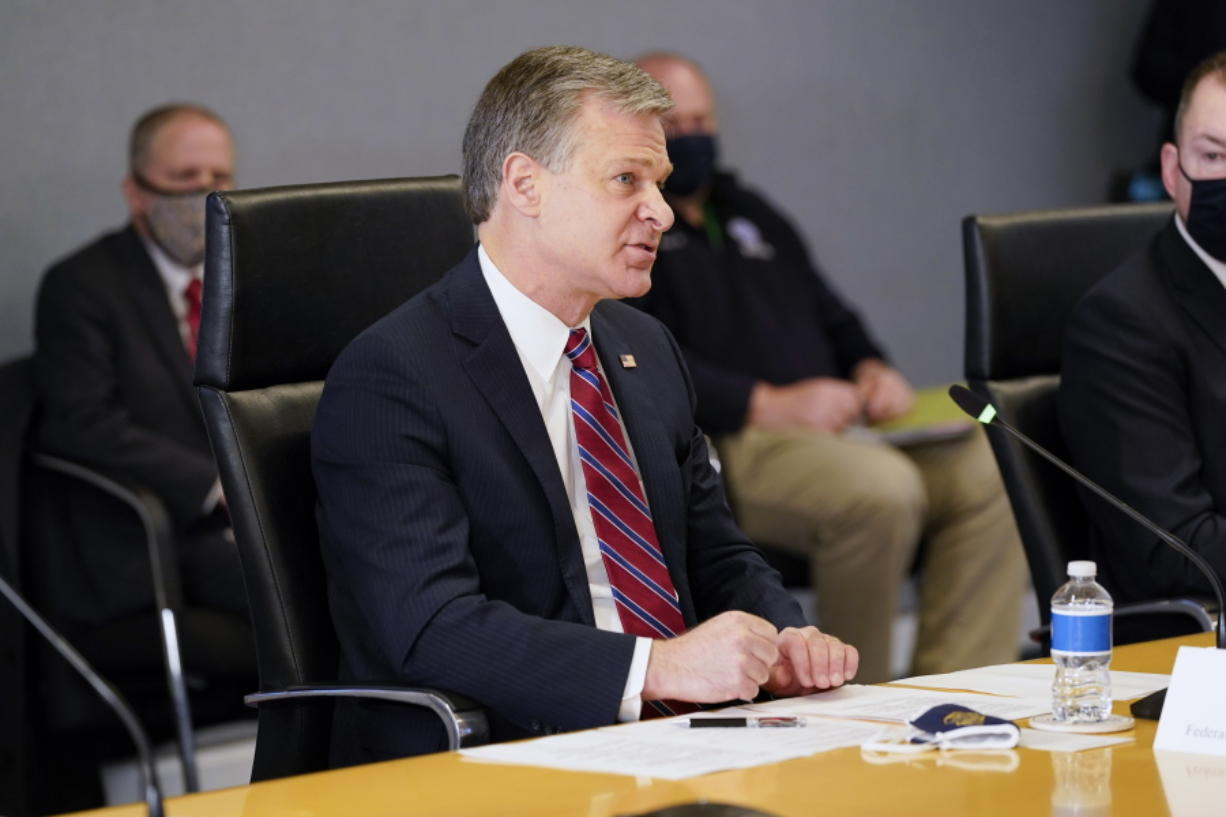 FBI Director Christopher Wray speaks during a briefing about the upcoming presidential inauguration of President-elect Joe Biden and Vice President-elect Kamala Harris, at FEMA headquarters, Thursday, Jan. 14, 2021, in Washington.