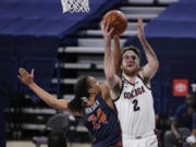 Gonzaga forward Drew Timme (2) shoots while pressured by Pepperdine forward Kene Chukwuka (24) during the first half of an NCAA college basketball game in Spokane, Wash., Thursday, Jan. 14, 2021.